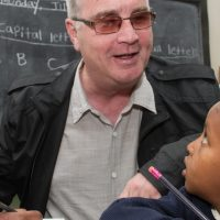 Richard Moore with school children in Ethiopia.