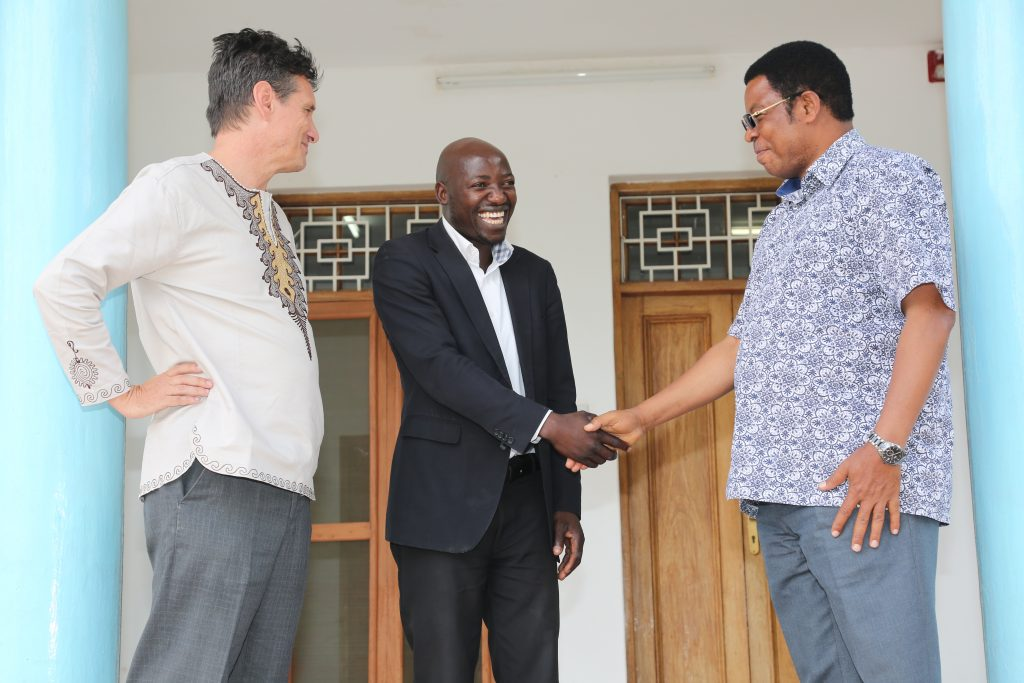 Joseph Ngololo from Children in Crossfire's Tanzanian office meeting with the Honourable Kassim Majaliwa.