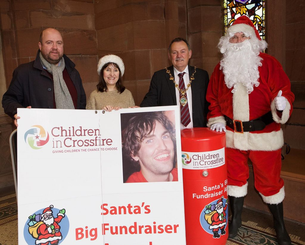 Derry City Mayor, Councillor Maolíosa McHugh with Martin and Mary Gallagher and Ronan McCay (Head of Fundraising at Children in Crossfire) launching Santa's Big Fundraiser Appeal at the Guildhall.