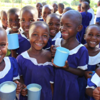 Pre-primary pupils in Misungwi happily drink porridge during their break time.