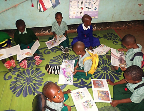 Children in pre-reading learning area in the classroom