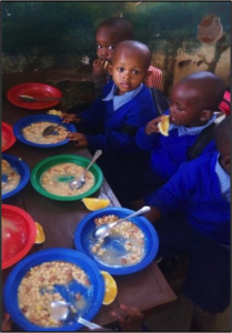 Magereza pre-primary pupils eating their school meal.