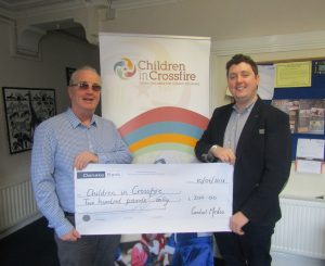 Contact Media's Director, Joseph McVeigh, presents cheque to Children in Crossfire's Executive Director, Richard Moore.