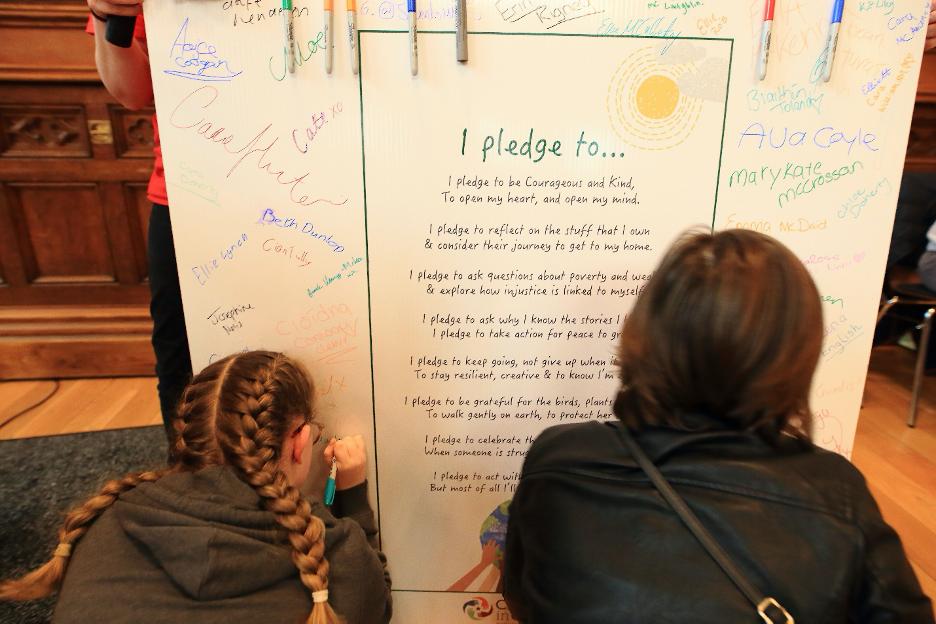 Two School Girls writing on board
